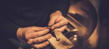 wedding ring prices jeweller at work