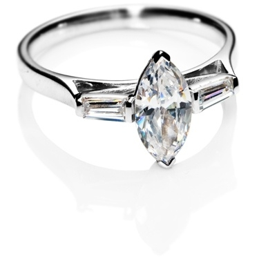 Marquise diamonds trilogy engagement ring